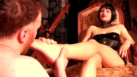Male foot slave licking his mistress's sexy black boots and feet