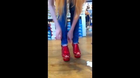Hottie is in shopping trying on some sexy high heels