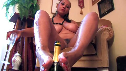 Bust mature lady in stockings pours champagne all over her feet
