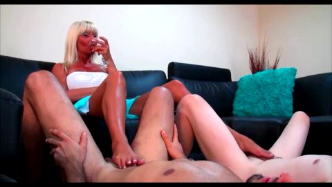 Naughty blonde with big tits giving two footjobs all at once
