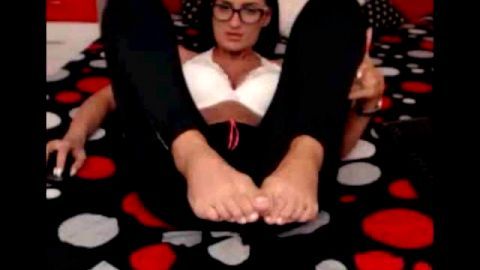 Sexy brunette with glasses loves playing with her webcam feet