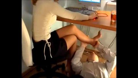 Submissive guy worshipping horny secretary's sexy feet and nylon stockings