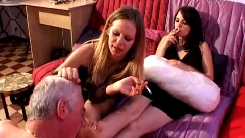 Older slave sucking toes while girls smoke