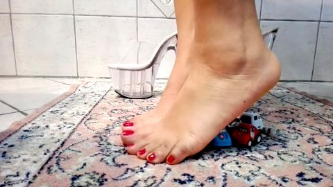 Slut with sexy feet gets in her shoes and crushes toy cars really badly