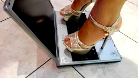 Naughty girls crushing laptop's keyboard with their kinky shoes