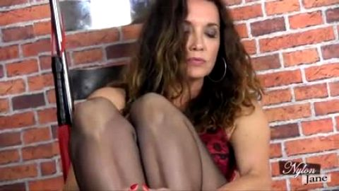 MILF in hot black stockings giving one of the best footjobs ever