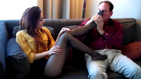 Asian hottie in black stockings sits on the sofa and gives an older guy a great footjob