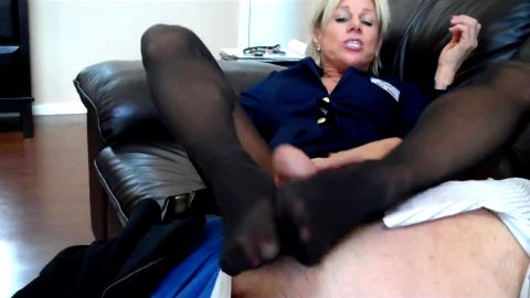 Naughty mature woman in nylon sits on her man's face before delivering a great footjob