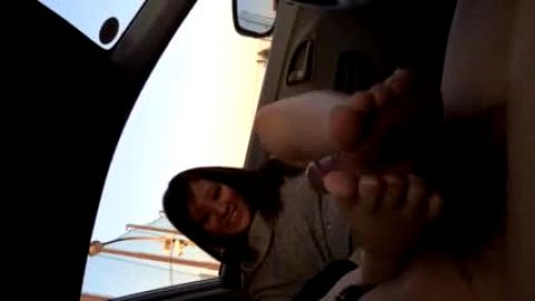 Cute Asian girl giving a guy with a hairy cock a great footjob in the car