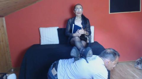 Slutty mature woman with glasses torturing her horny male foot slave