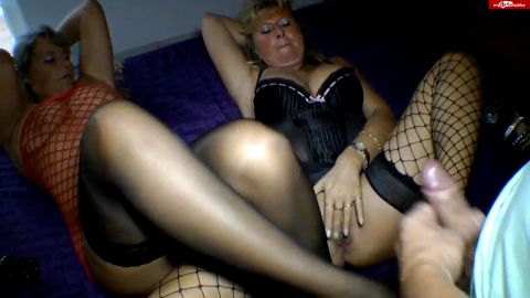 Lucky guy gets a double footjob by two attractive mature women