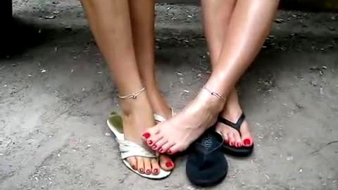 Hot Tanya and Lana loves playing sex games with their amateur feet outdoors