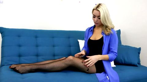 Beautiful blonde trying on her sexy legs and feet some sexy nylon stockings