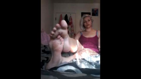 Lovely blonde puts her sexy foot between her toes and she loves it