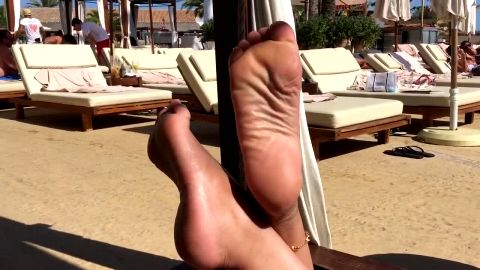 Horny lady plays with her delicious naked amateur feet and toes at the beach