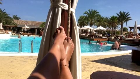 Horny amateur lady plays with her amazing legs and oiled up feet near the pool