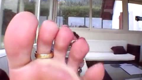 Gorgeous lady in sexy jeans enjoys wearing sexy toe ring on her attractive feet