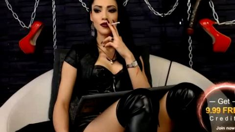 Smoking cam girl in black leather boots