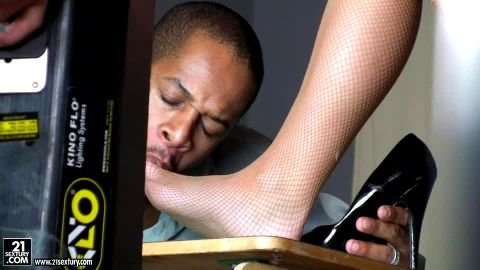 Bimbo in sexy uniform and stockings Carla Cox giving a shoejob & footjob