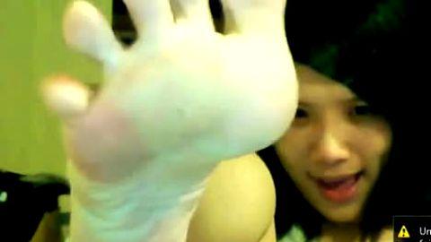 Adorable Asian teen showing her cute feet