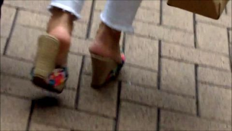 Naughty voyeur camera gets turned on in public by sexy babes in wedge heels