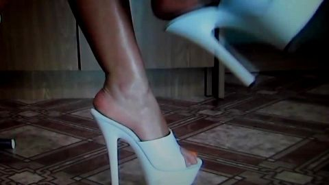 Naughty chick looks absolutely amazing wearing sexy high heel shoes with white platform