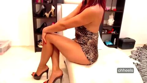 Hot MILF wearing sexy leopard outfit and provocative shoes with high heels on her amazing feet