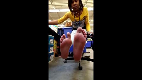 Bored ebony chick does not know what to do with her sexy feet at the office