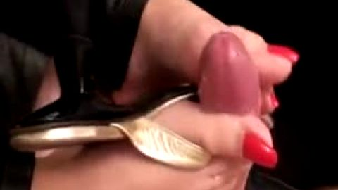 Kinky mature lady touches a nice cock with her sexy toes and makes them cum