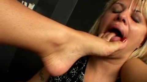 Sexy Brazilian girl makes her submissive girlfriend lick her attractive feet in bed