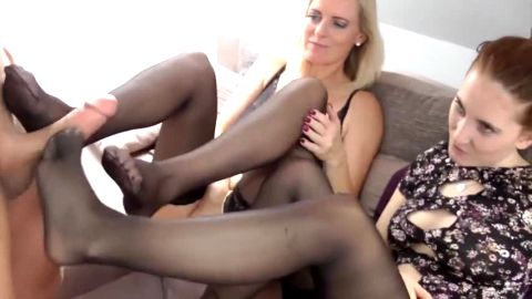 Wild German MILF & ten in sexy stockings giving a handsome guy a great footjob at the same time