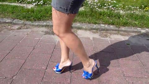 Hot MILF in short skirt walking in sexy blue high heel mules down town