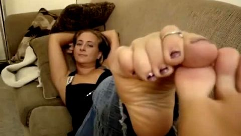 Lazy MILF is on the sofa playing with her smooth soles and sexy mature feet