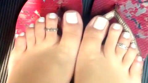 Cute amateur feet with interesting toe rings looks so good in flip flops