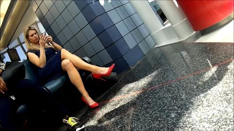 Phenomenal sophisticated lady looks perfect in her sexy summer dress and red high heel shoes