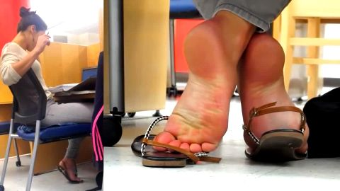 Hot secretary wearing cute sandals on her beautiful feet at the office