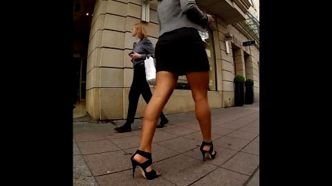Naughty voyeur noticed sexy brunette on the street wearing short skirt and hot high heel shoes