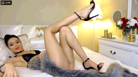 Gorgeous dark haired webcam girl wearing sexy lingerie and shoes on her hot feet