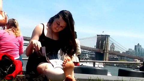 Fantastic girls enjoy resting their soft naked feet down town New York city