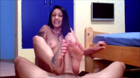 Slutty tattooed chick blows a nice cock and delivers a sensational footjob