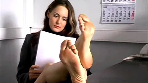 Smoking hot secretary resting her sexy legs and feet at the office