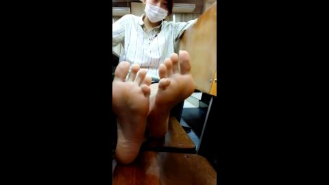 Phenomenal Taiwan girl puts her sexy feet on the chair and plays with them