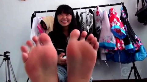 Pretty Chinese babe takes her snickers off and shows off her sexy Asian feet at the boutique
