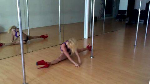 Pole dance in high stripper red platform