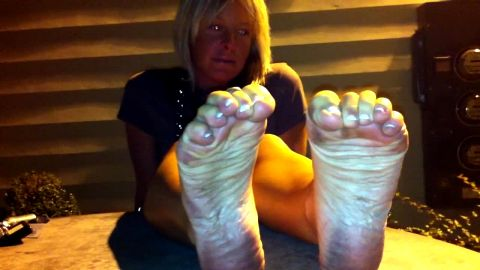 Wonderful blonde MILF loves showing her soft dirty feet and soles outdoors