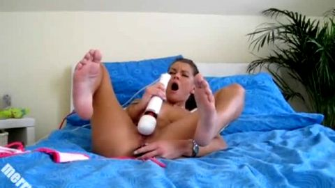 Kinky German slut takes her sexy bikini off and toys her pink holes