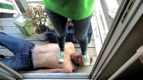Kinky chick tramples a slave and makes him lick her dirty shoes