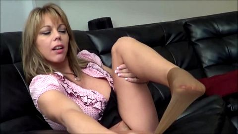 Sexy secretary in pantyhose and short skirt resting on the sofa after long day at work