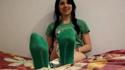 Delicious teenage brunette wearing sexy green soccer socks in her bed