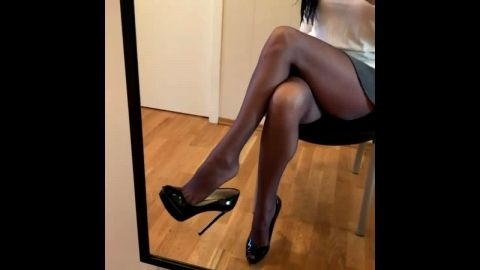Hot brunette knows that her sexy legs and feet look amazing in black stockings